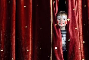 Kid Peeking Through Stage Curtain