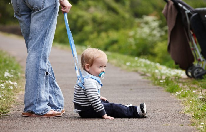 Cute 18 month old boy on footpath