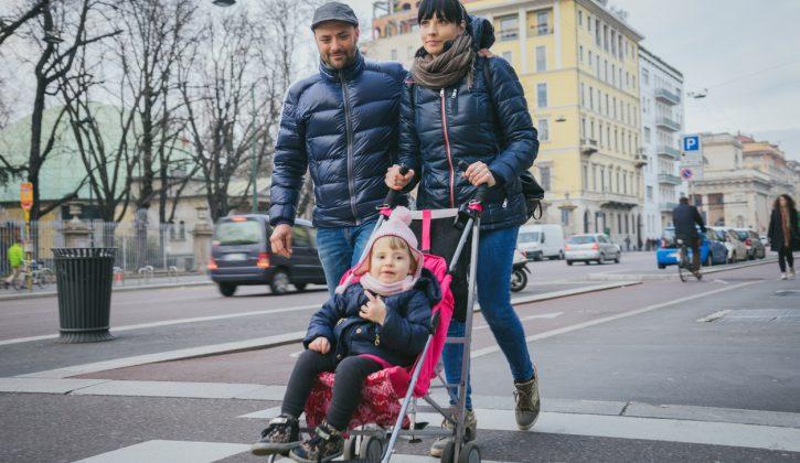 Happy family crossing the street.