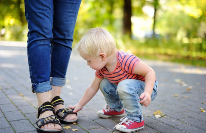 Kid Wearing Shoes with Mom