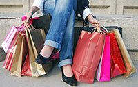 woman_holding_lots_of_shopping_bags