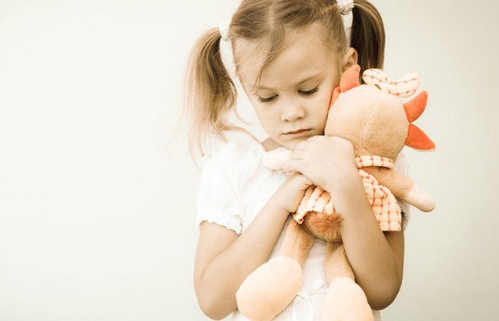 sad-girl-with-her-stuffed-animal