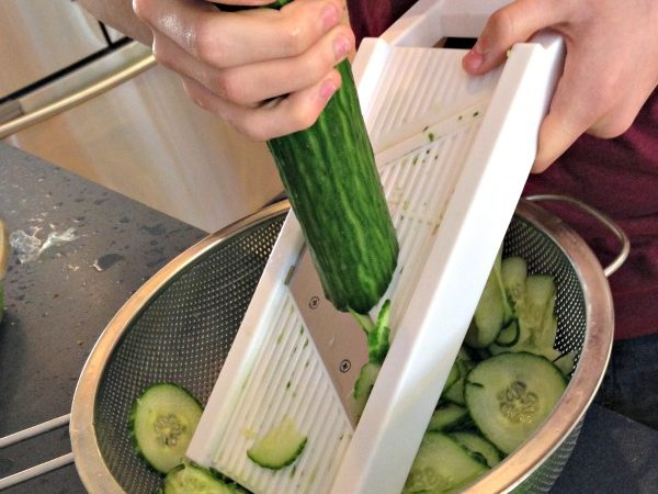 Slicing-cucumbers-with-a-mandolin