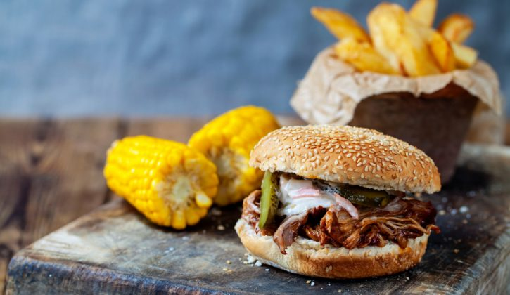 Pulled Pork sandwich with fries and corn on the cobb
