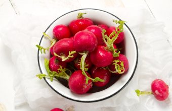 Whole Red radishes in white bowl