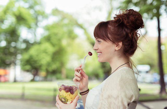 woman_eating_fruit_salad