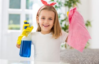 Happy smiling cute girl successful doing housework obligations