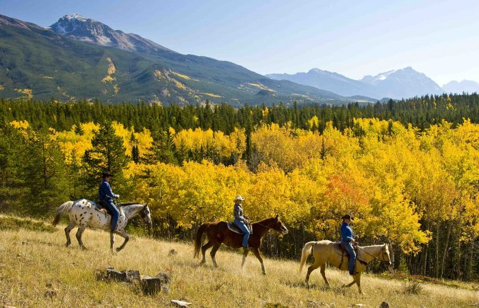 Horseback-Riding-through-Fall-leaves-