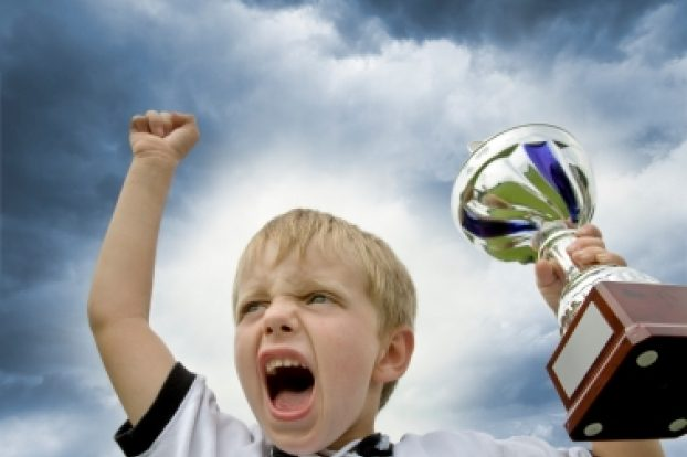 kid-winning-with-trophy