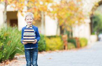 Kid Holding Lunchbox Outside