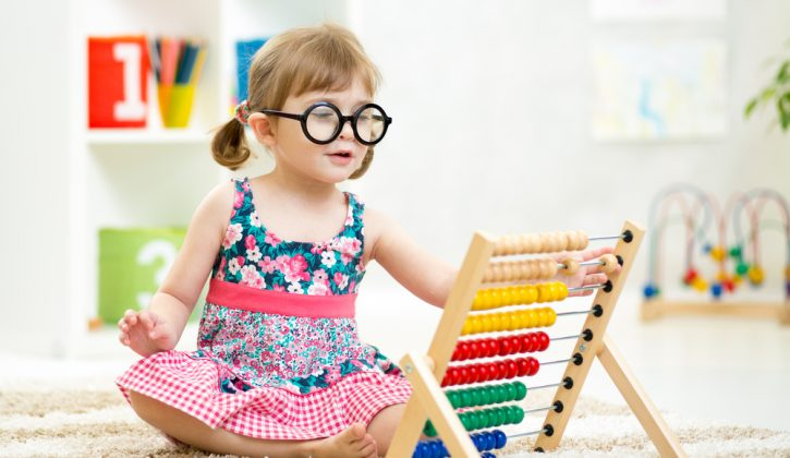 Smart Kid Playing with Educational Toy