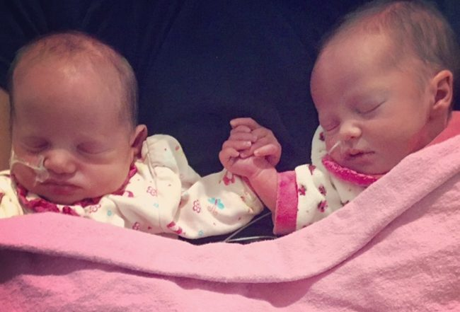 twins hold hands